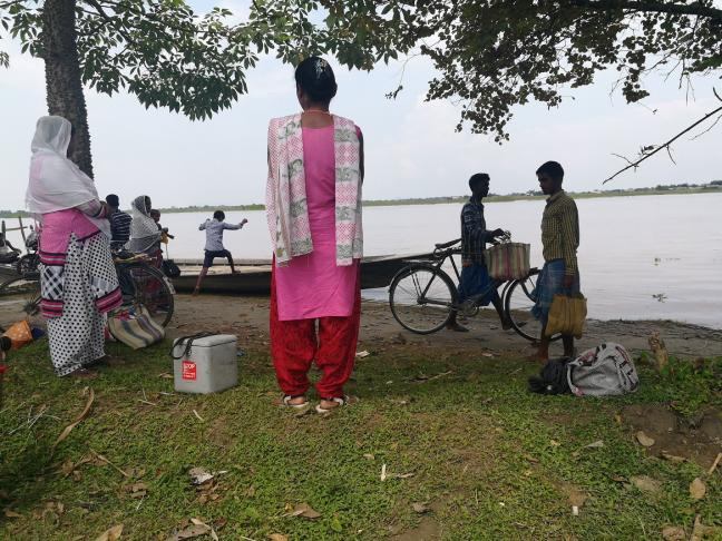 Ramhari char: Nurses waiting for a boat to take then to the sub-centre where they work.