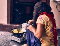 Even if a rural household cooks one or two of its daily meals in electric/induction cookstoves, it helps bring down indoor emissions. Photo by Ashwini Chaudhary/Unsplash.